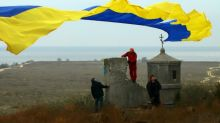 Three navy ships held by Russia return to Ukraine port