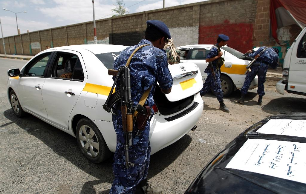 Yemeni soldiers search cars at a checkpoint as authorities tighten up security measures in the capital Sanaa on September 20, 2016