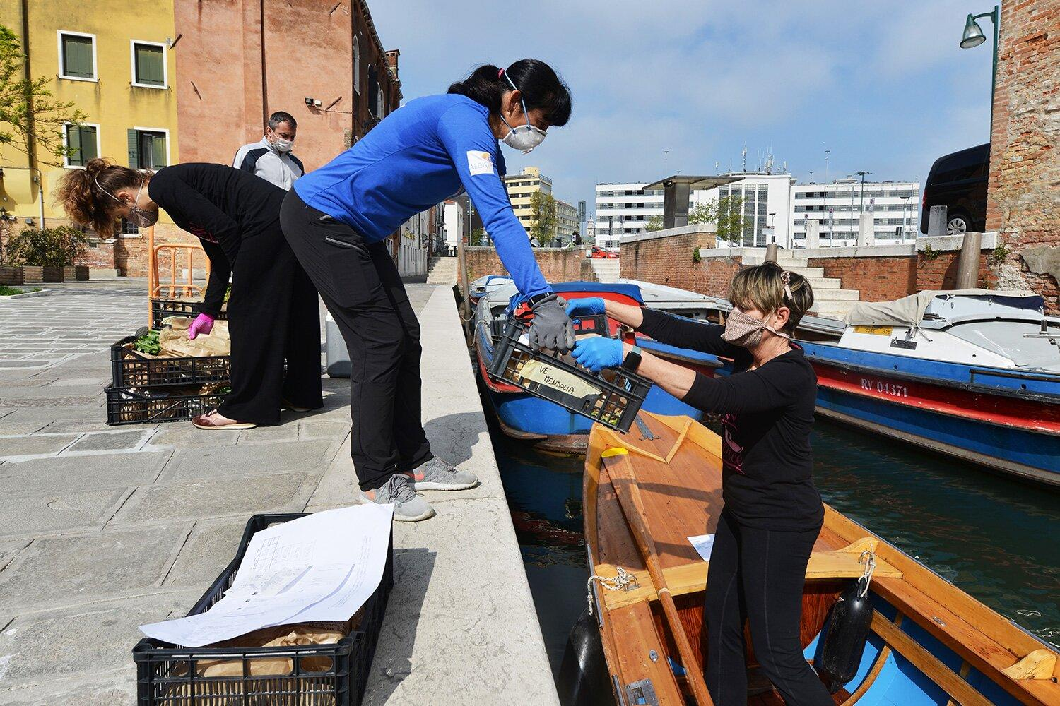 Female Rowers in Venice Using Gondolas to Deliver Groceries to ...