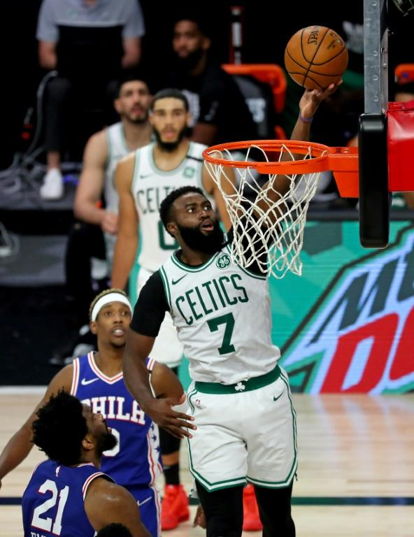 Boston's Jaylen Brown drives to the basket against Philadelphia's Joel Embiid in the Celtics' 102-94 NBA playoff win over the 76ers