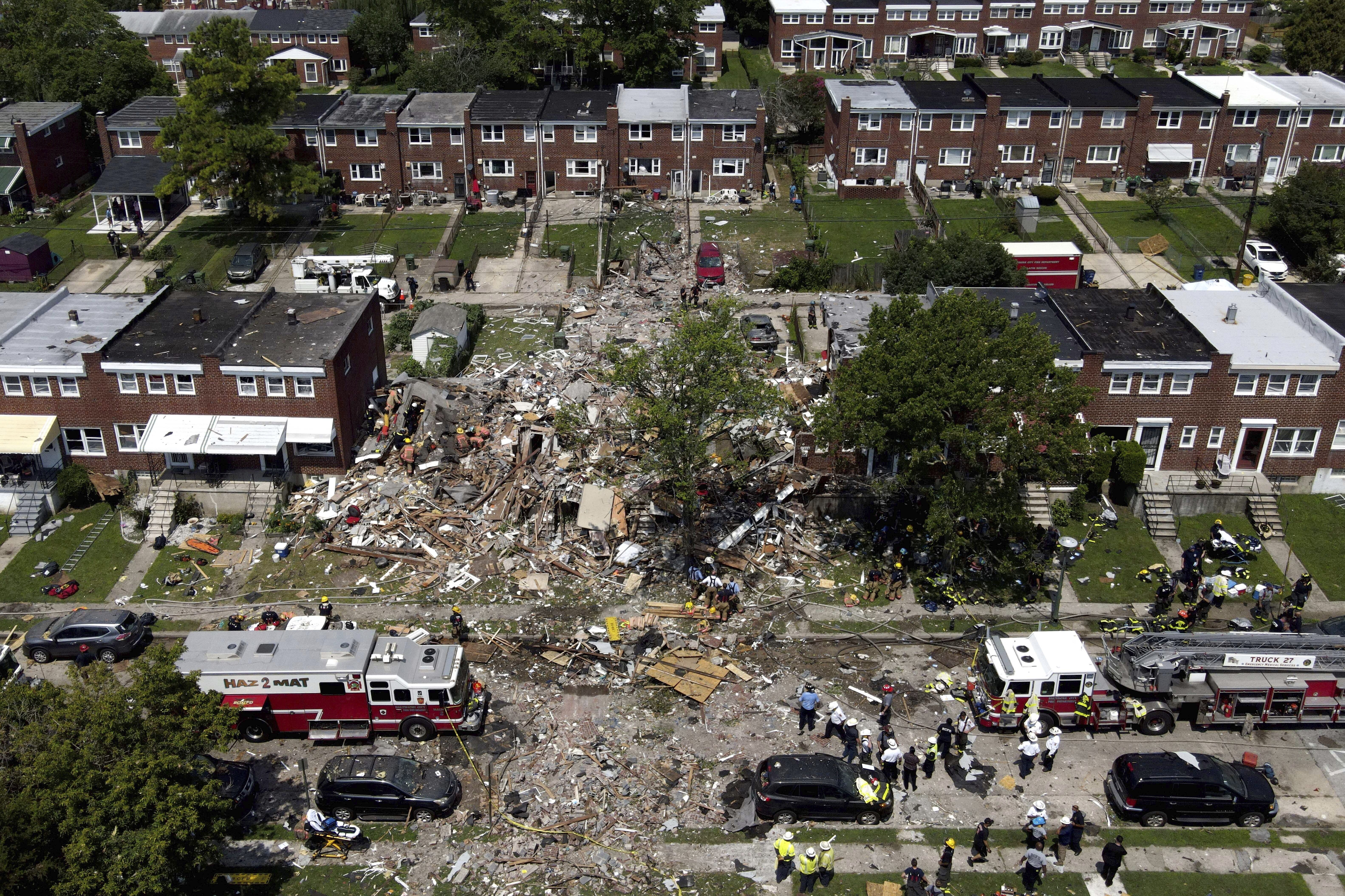 Debris and rubble covers the ground in the aftermath of an explosion in Baltimore on Monday, Aug. 10, 2020. Baltimore firefighters say an explosion has leveled several homes in the city. (AP Photo/Julio Cortez)