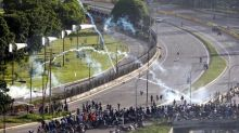 Venezuelan troops fire on protesters; one killed