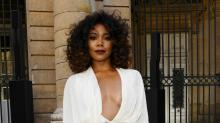 Gabrielle Union Stuns in White Pantsuit Sitting Front Row at a Fashion Show
