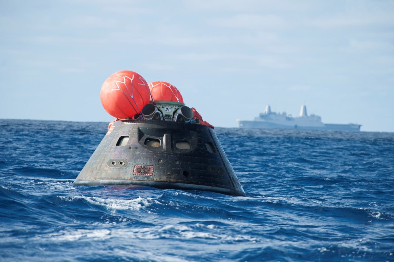 NASA's Orion spacecraft awaits the U.S. Navy's USS Anchorage for a ride home. Orion launched into space on a two-orbit, 4.5-hour test flight at 7:05 am EST on Dec. 5, and safely splashed down in the Pacific Ocean, where a combined team from NASA, the Navy and Orion prime contractor Lockheed Martin retrieved it for return to shore on board the Anchorage. It is expected to be off loaded at Naval Base San Diego on Monday. (Photo by VCG Wilson/Corbis via Getty Images)