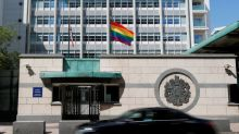 Putin mocks U.S. embassy for flying rainbow flag