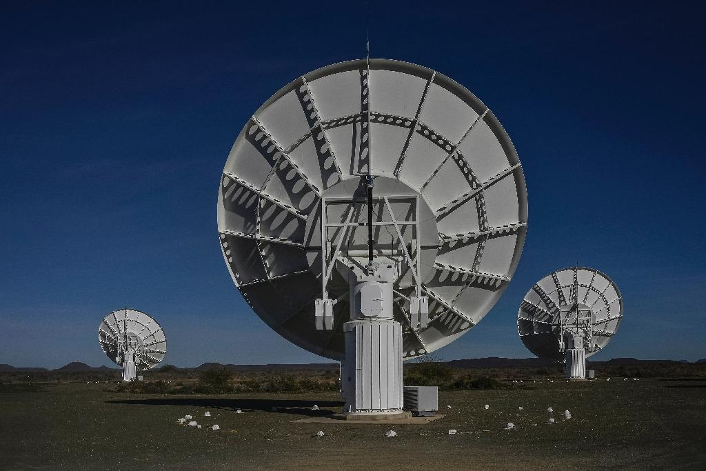 Part of the ensemble of dishes forming South Africa's MeerKAT radio telescope is seen in Carnarvon on July 16, 2016 (AFP Photo/Mujahid Safodien)