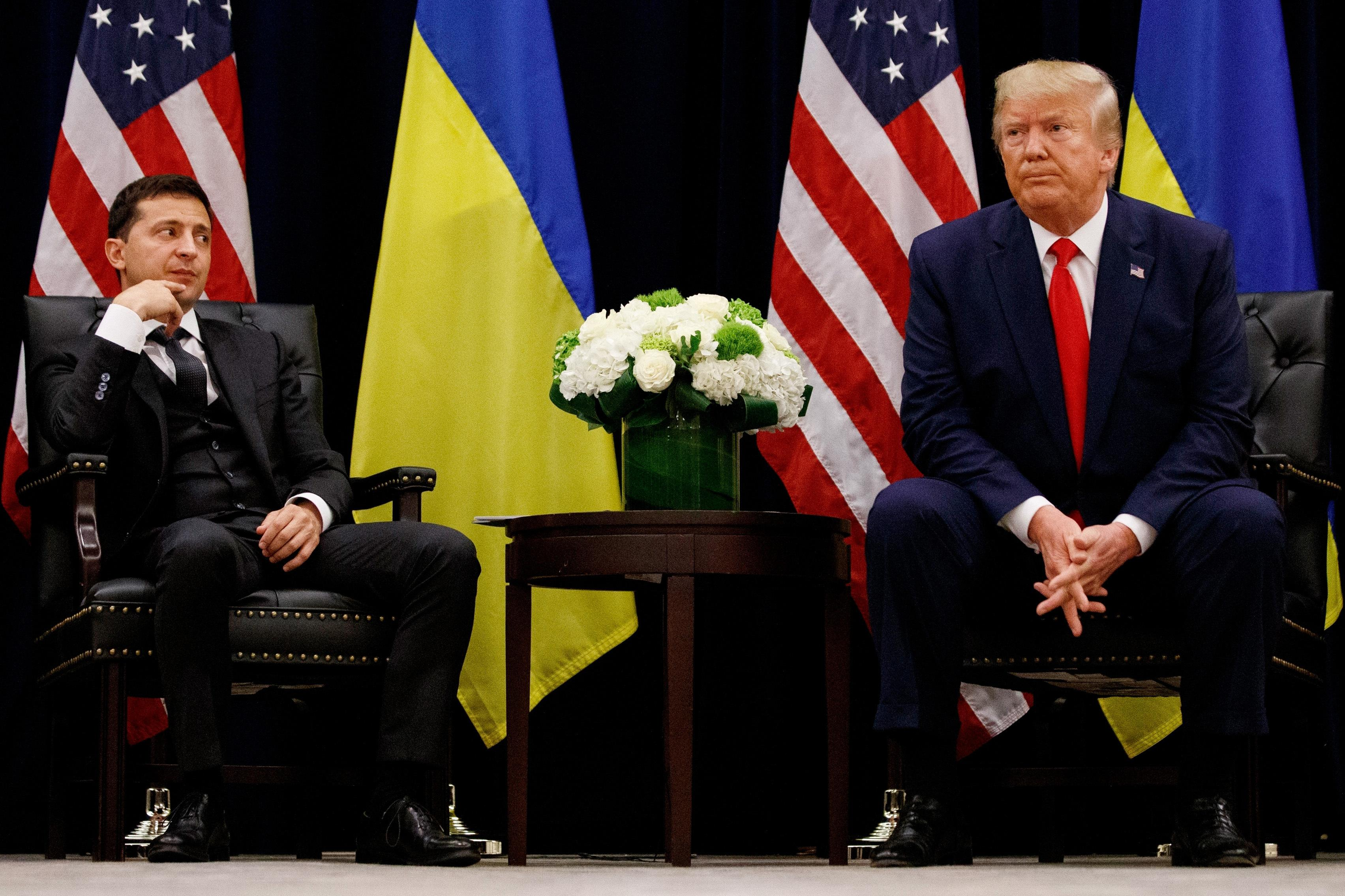 FILE - In this Sept. 25, 2019 file photo, President Donald Trump meets with Ukrainian President Volodymyr Zelenskiy in New York during the United Nations General Assembly. Trump's demand that Ukraine look into its own purported interference in the 2016 U.S. election and investigate a political rival, former Vice President Joe Biden, while the U.S. withheld the aid is at the heart of the congressional investigation that produced Trump's impeachment in the House on charges of abuse of power and obstruction of Congress. (AP Photo/Evan Vucci, File)