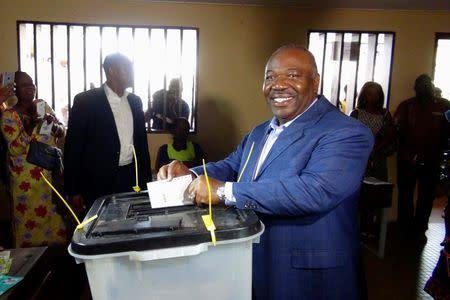 Gabon's President Ali Bongo Ondimba votes during the presidential election in Libreville, Gabon