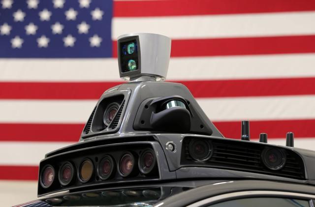 Alphabet asks court to halt Uber's self-driving car project