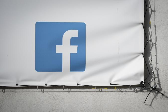 A Facebook logo is seen on a banner in Bydgozcz, Poland on March 8, 2019. (Photo by Jaap Arriens/NurPhoto via Getty Images)