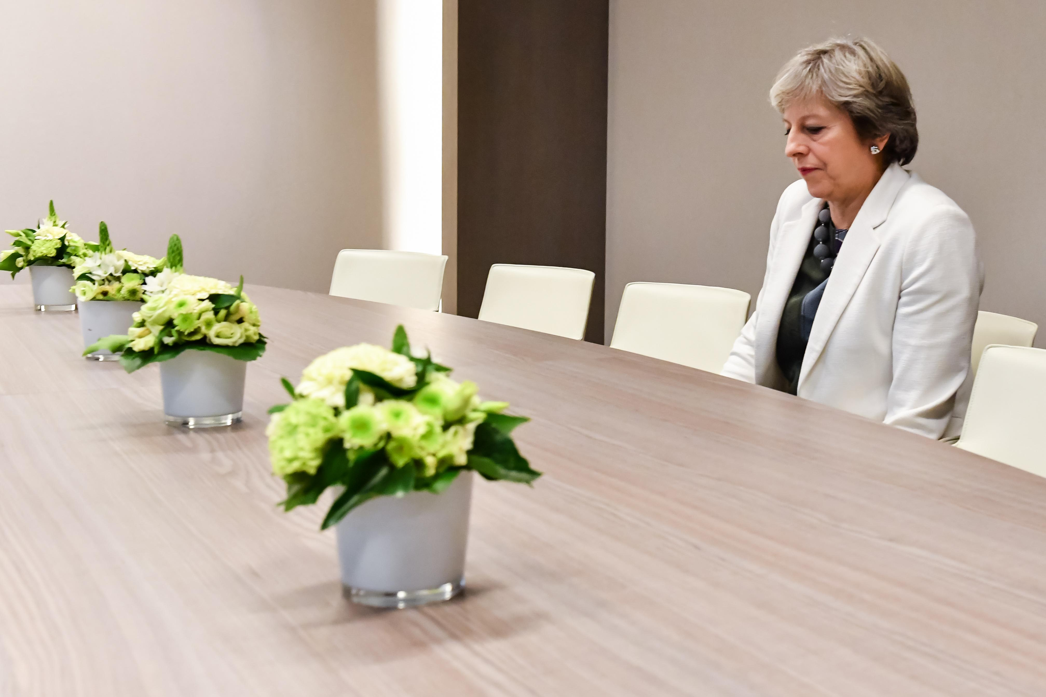 A Photo of Lone Theresa May Arrived. The Internet Could Not Ignore the Meme Opportunities.