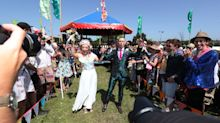 Now that's a wedding band! Couple get married in front of hundreds at Glastonbury
