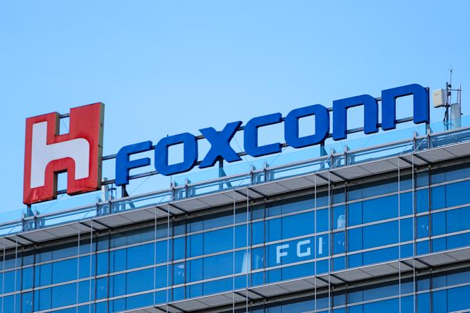 The logo of Foxconn, or Hon Hai Group , which is Taiwans technology giant and the worlds leading producer of semiconductors or chips particularly for Apples devices, is seen on top of the companys headquarters, amid COVID-19 outbreak , in Taipei, Taiwan, 15 July 2021. Foxconn has together with TSMC helped Taiwan to buy BioNTech vaccines. (Photo by Ceng Shou Yi/NurPhoto via Getty Images)