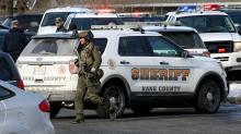 Gunman kills five people, wounds five police in US building