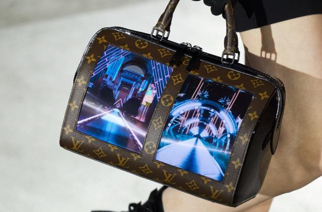 Louis Vuitton's flexible-screen handbags are the definition of extra