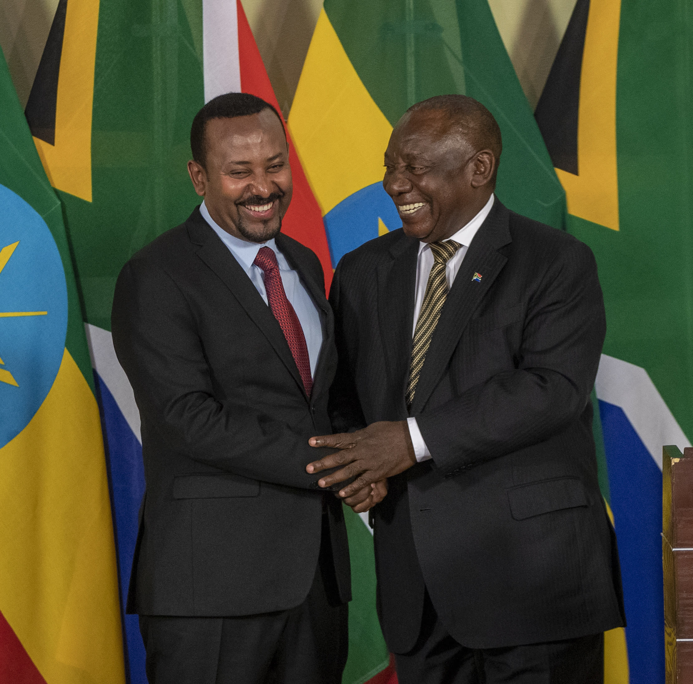 South African President Cyril Ramaphosa, right, shakes hand with Ethiopia's Prime Minister Abiy Ahmed after their joint media conference at the Union Building in Pretoria, South Africa, Sunday, Jan. 12, 2020. (AP Photo/Themba Hadebe)