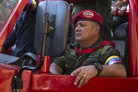 Venezuela's National Assembly President Cabello drives car during rally to commemorate 23rd anniversary of 1992 coup attempt led by former President Chavez, in Caracas