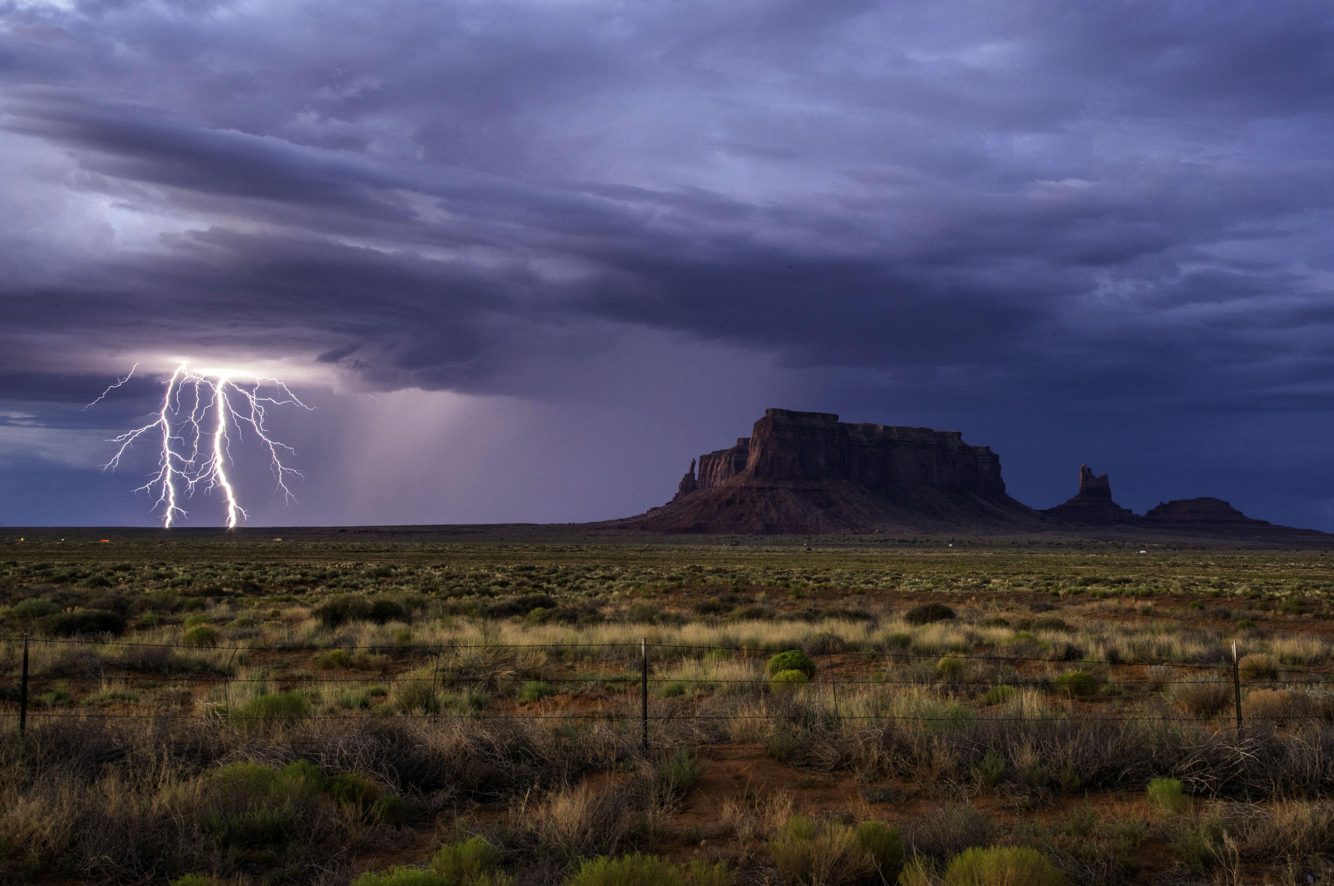 <p>Rain and lightning bolts hammer the desolate terrain of Monument Valley, Ariz. (Photo: Jennifer Khordi/Caters News) </p>