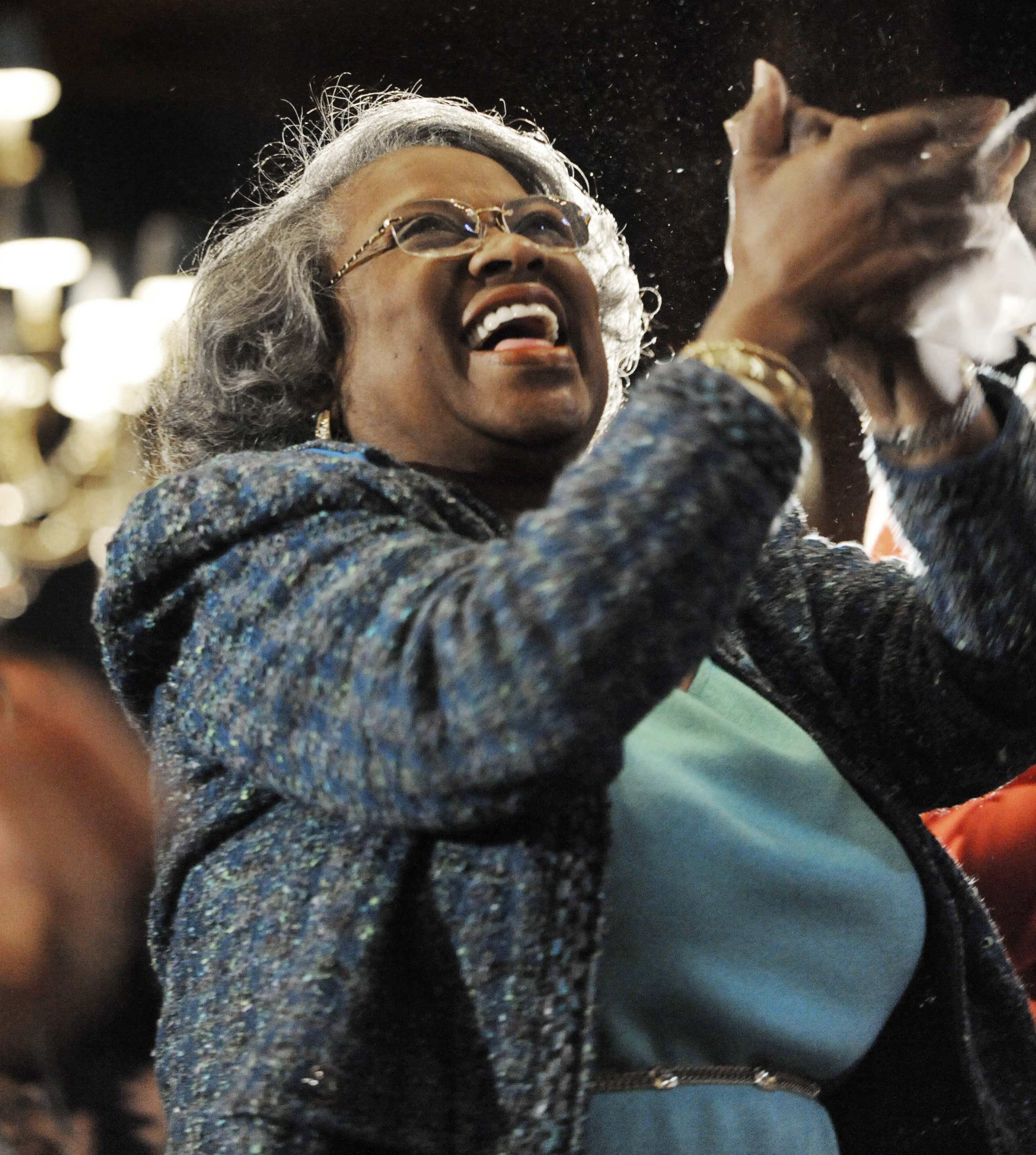 FILE - In this Monday, Jan. 21, 2013 file photo, Juanita Abernathy, widow of civil rights leader Ralph Abernathy, celebrates while watching a live video feed of President Barack Obama's inauguration after speaking at the Union League Club of Chicago in Chicago. Juanita Abernathy, who wrote the business plan for the 1955 Montgomery Bus Boycott and took other influential steps in helping to build the American civil rights movement, has died. She was 88. Family spokesman James Peterson confirmed Abernathy died Thursday, Sept. 12, 2019 at Piedmont Hospital in Atlanta following complications from a stroke. (AP Photo/Paul Beaty, File)