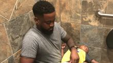 Photo of dad changing his son's diaper in a public restroom goes viral: 'There are guys who take care of their kids too'