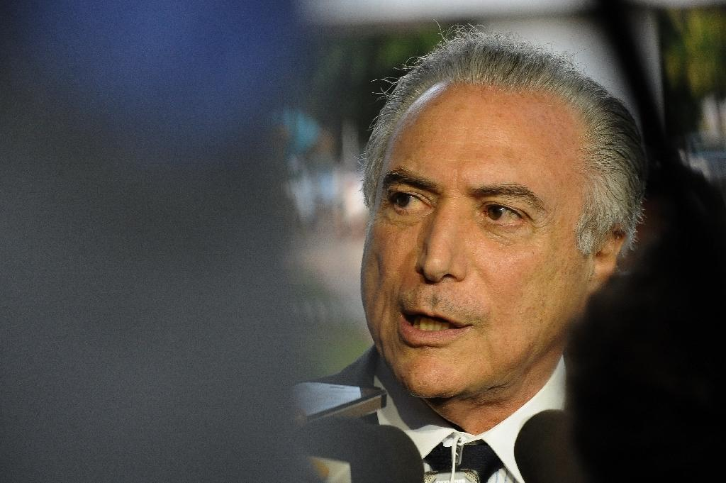 The immediate winner is Rousseff's vice president, Michel Temer, who has become her leading opponent and under the constitution would take power the moment a Senate trial started. (AFP Photo/ANDRESSA ANHOLETE)