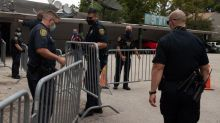 Men seen forcing open backdoor of China's Houston consulate after closure