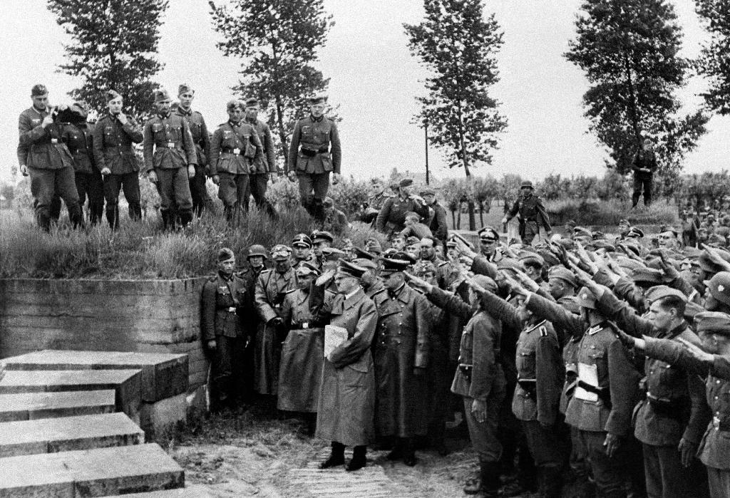 Adolf Hitler pays tribute to German soldiers fallen during World War I, during a 1940 visit to the Langemark cemetery in Belgium