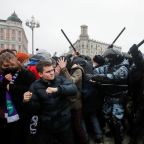 Woman kicked by Russian policeman becomes protest symbol, seeks justice