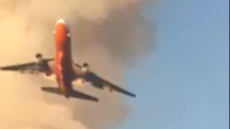 Jet Drops Retardant on California Wildfire