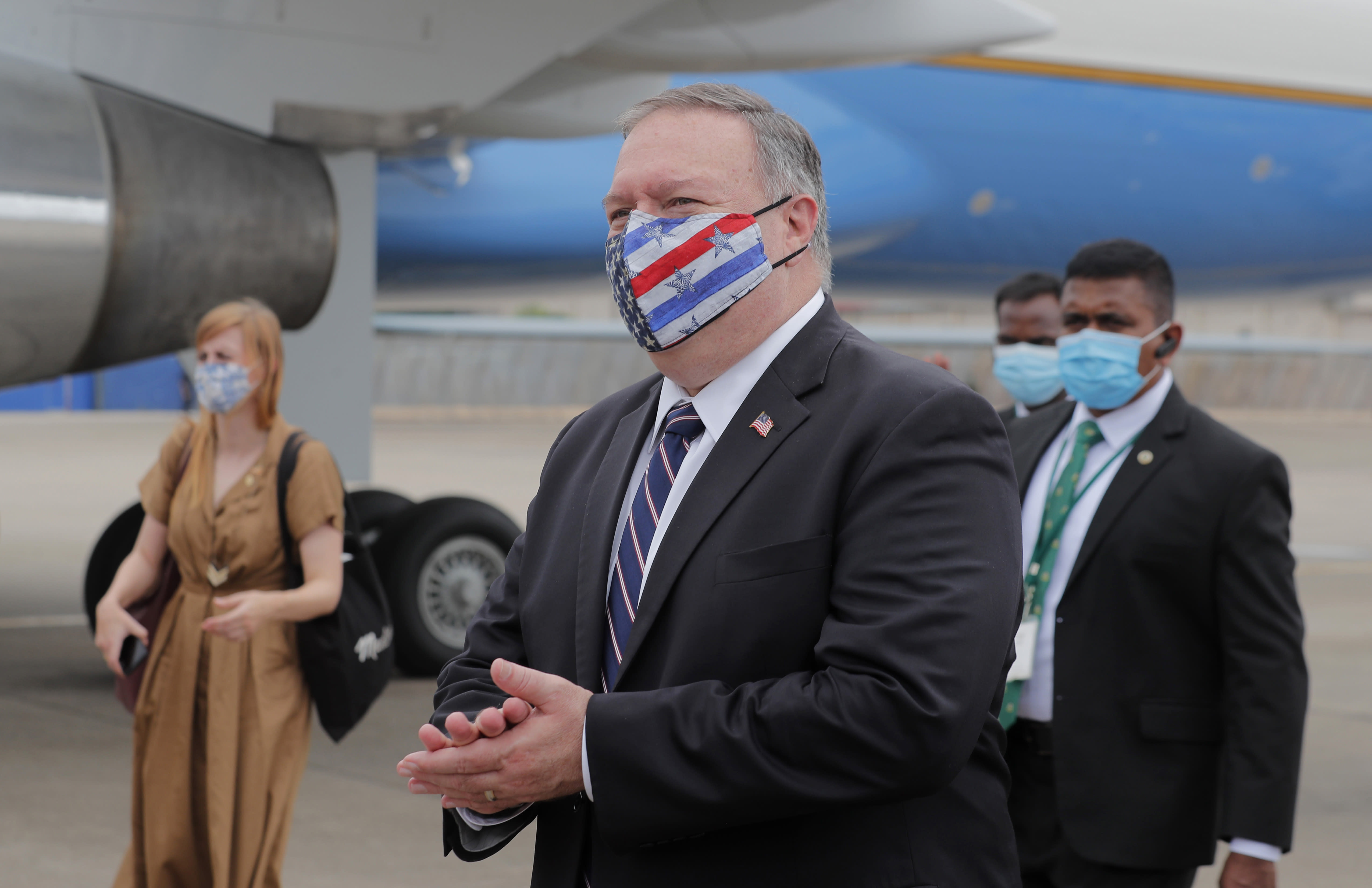 U.S. Secretary of State Mike Pompeo walks to board an aircraft to leave for Maldives, in Colombo, Sri Lanka, Wednesday, Oct. 28, 2020. Pompeo plans to press Sri Lanka to push back against Chinese assertiveness, which U.S. officials complain is highlighted by predatory lending and development projects that benefit China more than the presumed recipients. The Chinese Embassy in Sri Lanka denounced Pompeo's visit to the island even before he arrived there, denouncing a senior U.S. official's warning that the country should be wary of Chinese investment. (AP Photo/Eranga Jayawardena, Pool)