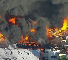 Los Angeles fire: 100 fire-fighters tackle huge blaze at apartment building in Pico Rivera