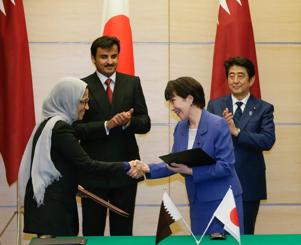 Qatar's Sheikh Tamim bin Hamad al-Thani (2nd-L) issued a decree appointing women to the country's Shura Council for the first time, one of whom is current Minister of Information and Communications Technology Hessa Al Jaber (L)