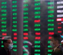Asian shares tumble as global recovery hopes falter