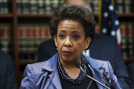 """United States Attorney Loretta E. Lynch speaks during an announcement of the arrest of Abraxas J. (""""A.J."""") Discala, CEO of OmniView Capital, and six co-conspirators for fraudulent market manipulation at the U.S. Attorney's office in Brooklyn, New York"""