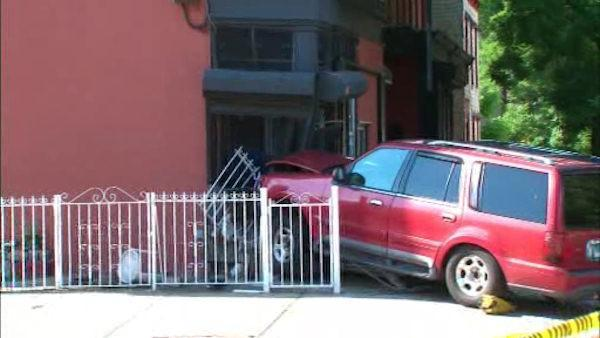 SUV allegedly fleeing accident hit building