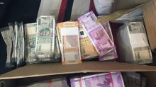 Rs 11 crore cash seized in income tax raids on former NSE bosses