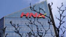 HNA unit to sell two Hong Kong sites to Henderson Land for $2 billion