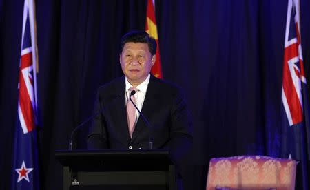 China's President Xi Jinping attends a news conference in Wellington