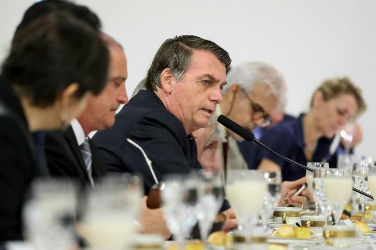 """Brazil's President Jair Bolsonaro tol foreign correspondents that reports of people going hungry in Brazil are """"a big lie,"""" despite a UN report that said 5.1 million Brazilian are """"undernourished"""" (AFP Photo/MARCOS CORREA)"""
