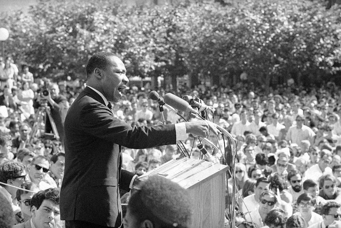 """FILE - In this May 17, 1967 file photo, Dr. Martin Luther King speaks at the University of California administration building in Berkeley, Calif. Fifty years ago, Martin Luther King Jr. asked Americans, """"Where do we go from here?"""" His warning of chaos or community squarely confronted racism, and marked a shift from his emphasis on nonviolence to a demand for full economic and political equality. Younger generations of black activists say they prefer the pointed, more forceful King to the Nobel Peace Prize-winning pacifist who preached love over hate. (AP Photo, File)"""