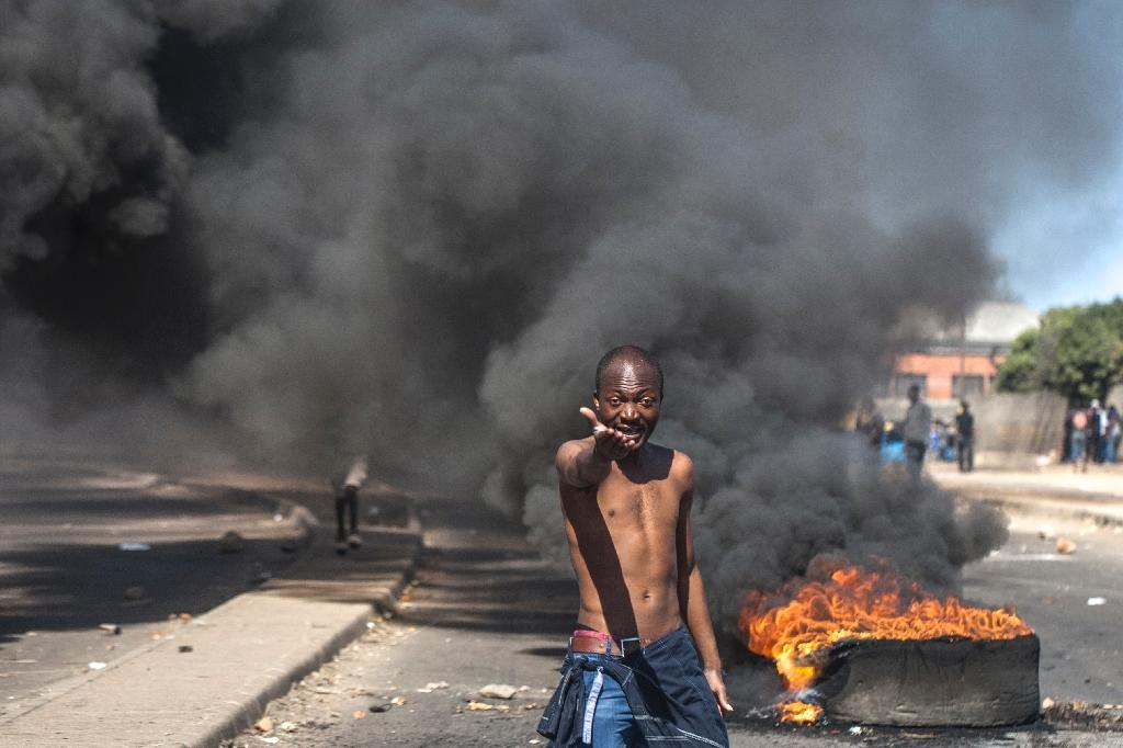 A series of anti-government protests have erupted in Zimbabwe in recent months over the worsening state of the economy (AFP Photo/STRINGER)