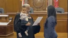 Heartwarming video shows judge holding a lawyer's baby while swearing her into state bar