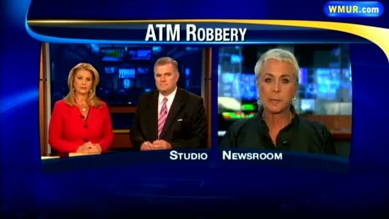 Man accused of robbing woman at ATM