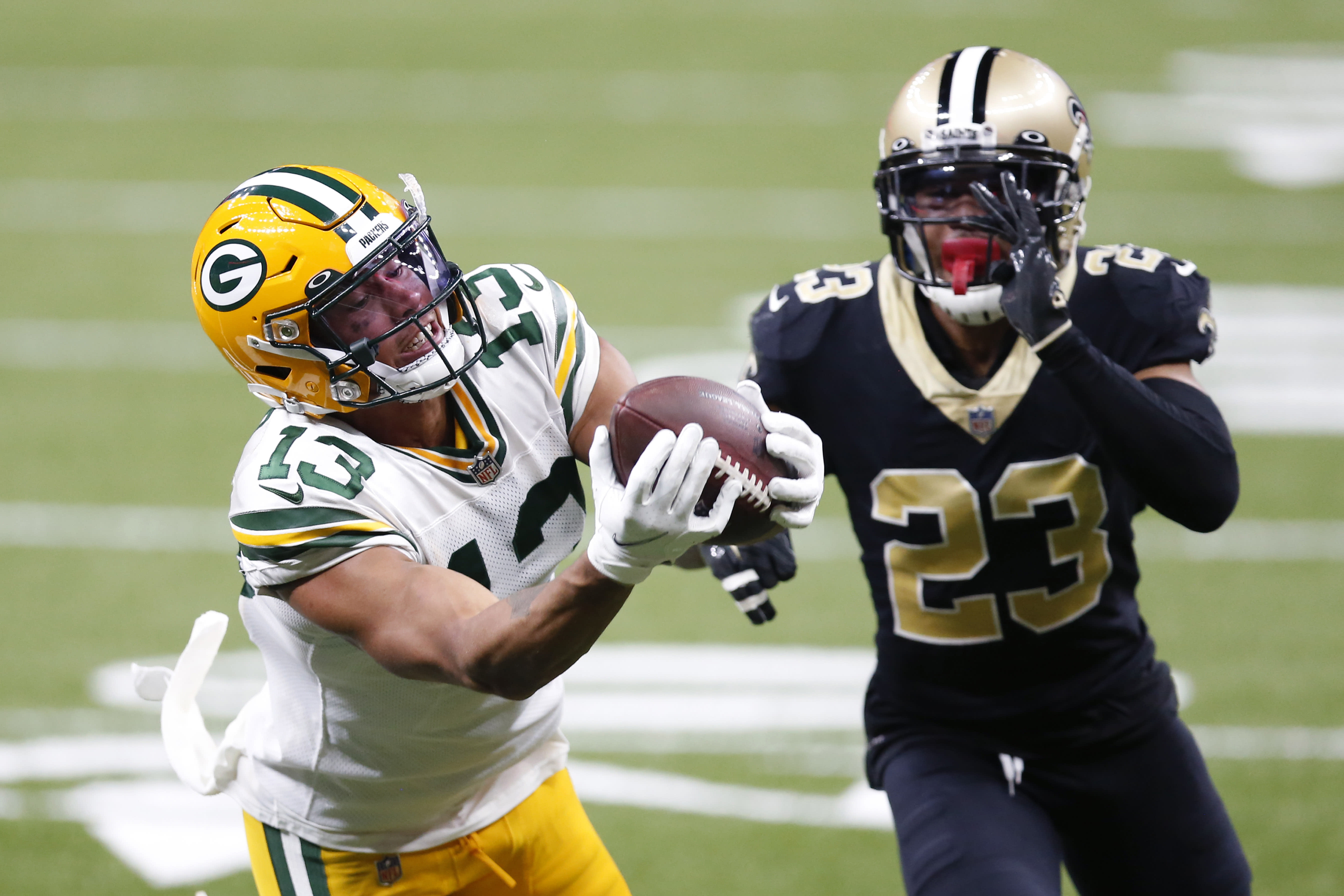 Green Bay Packers wide receiver Allen Lazard (13) pulls in a 48 yard pass in front of New Orleans Saints cornerback Marshon Lattimore (23) in the first half of an NFL football game in New Orleans, Sunday, Sept. 27, 2020. (AP Photo/Brett Duke)