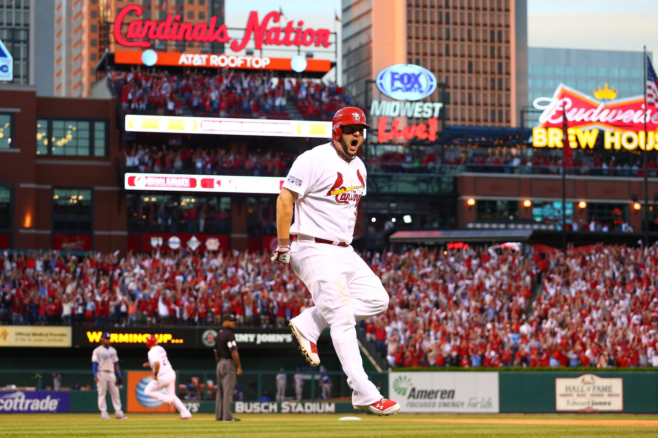 ST LOUIS, MO - OCTOBER 07:  Matt Adams #32 of the St. Louis Cardinals reacts after hitting a three run home run in the seventh inning against the Los Angeles Dodgers in Game Four of the National League Divison Series at Busch Stadium on October 7, 2014 in St Louis, Missouri.  (Photo by Dilip Vishwanat/Getty Images)