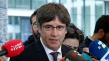 Carles Puigdemont: Former Catalan leader hands himself into Belgian authorities