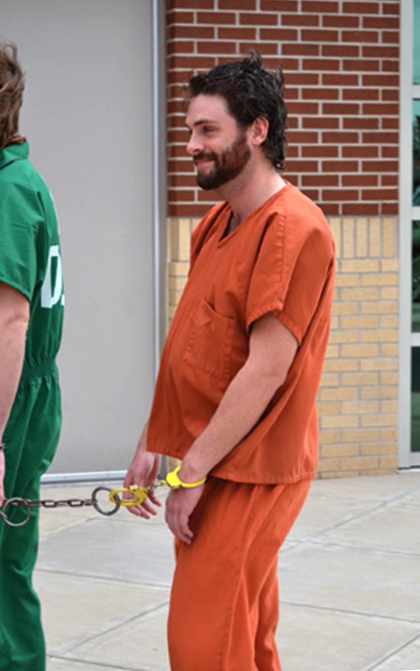 FILE - In this photo provided by the Miami News Record, Gregory Weiler II enters the Ottawa County Courthouse in Miami, Okla. Weiler, an Illinois man charged with plotting to firebomb dozens of churches in northeastern Oklahoma with Molotov cocktails, will be tried in federal _ not state _ court, authorities announced Wednesday, Feb. 6, 2013. (AP Photo/Miami News Record, Melinda Stotts, File)
