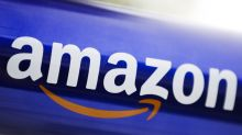 Companies to Watch: Amazon interested in Boost Mobile, Allianz strikes two deals, Tesla takes orders in China
