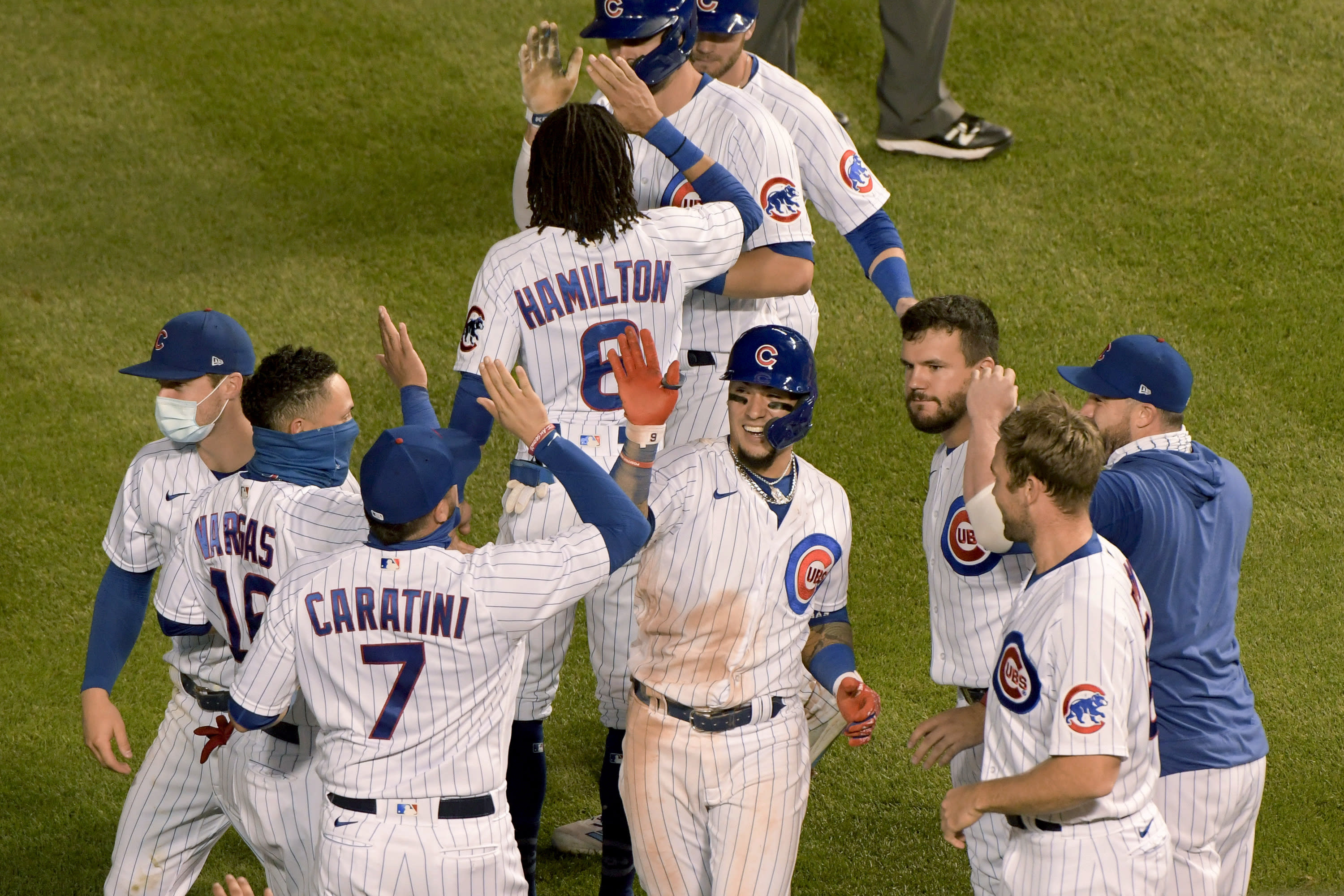 Chicago Cubs' Javier Baez (9) celebrates with teammates after driving in the winning run during the 10th inning against the Cleveland Indians in a baseball game Wednesday, Sept. 16, 2020, in Chicago. (AP Photo/Mark Black)