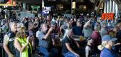 Individuals sit at the Full Throttle Saloon at the Sturgis motorcycle rally. (Getty Images)